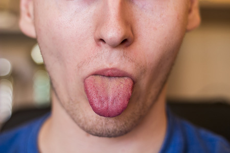 tongue out: Human tongue protruding out