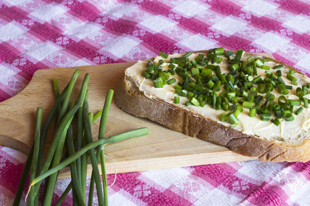 Bread with butter and chives photo