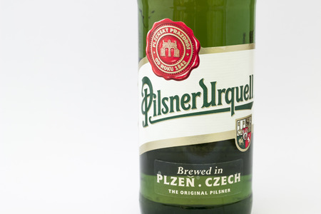 pilsner: BRNO  CZECH REPUBLIC  APRIL 24 2015: Pilsner Urquell pale lager beer isolated on white. It has been produced since 1842 in Pilsen Czech Republic.