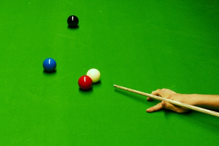 Snooker table with balls and cue ready for shot