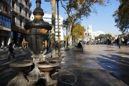 Barcelona Spain circa November 2016 the ancient and historical fountain on the rambla