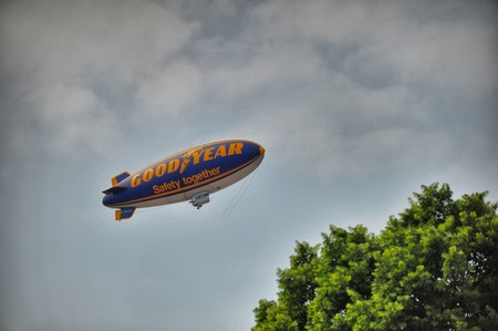 Goodyear blimp flying in the sky with the words Turin Italy circa May 2014 Editorial