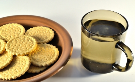 a plate of cookies and a cup of tea photo
