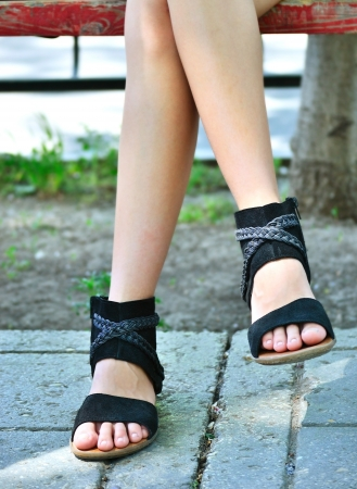 feet of a young girl in summer sandals photo