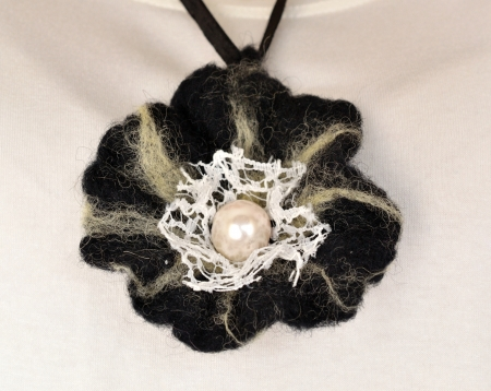 Womens pendant made of wool photo
