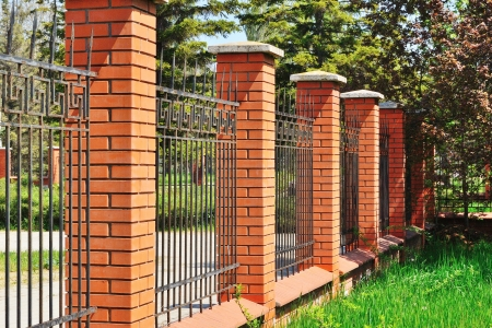 iron fence: fence of stone and metal