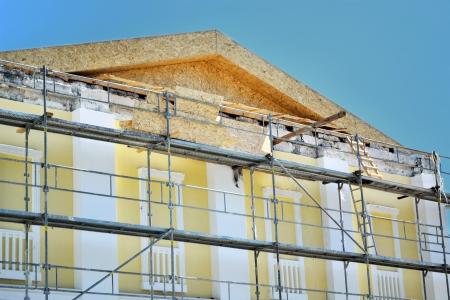 renovate old building facade: renovation of the facade of the building