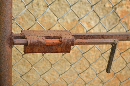 rusty bolt on the gate photo