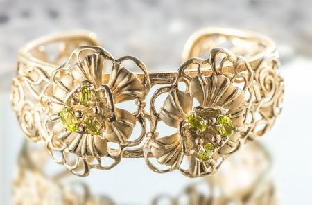 gold bracelet with emeralds Stock Photo