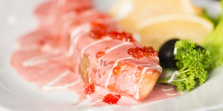 salmon with caviar sauce macro photo