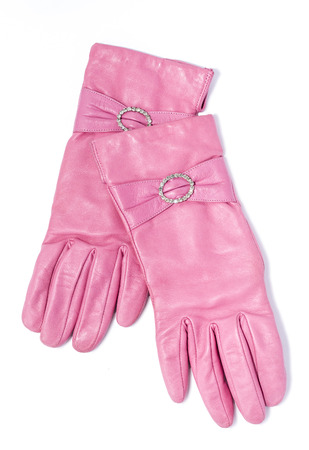 furskin: pink leather gloves on an isolated background Stock Photo