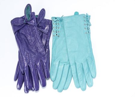 furskin: two pairs of leather gloves on an isolated background Stock Photo