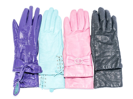 furskin: female leather gloves isolated on background