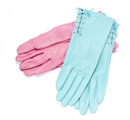 furskin: pink and blue leather gloves on an isolated background