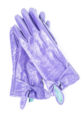 furskin: purple patent leather gloves on an isolated background