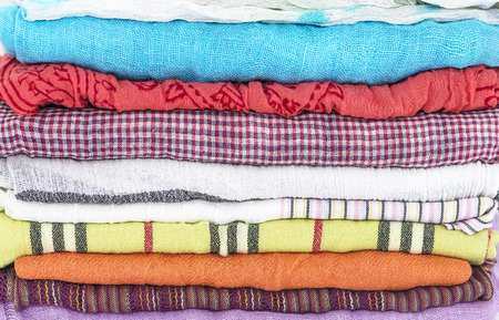 stack of colorful womens scarves photo