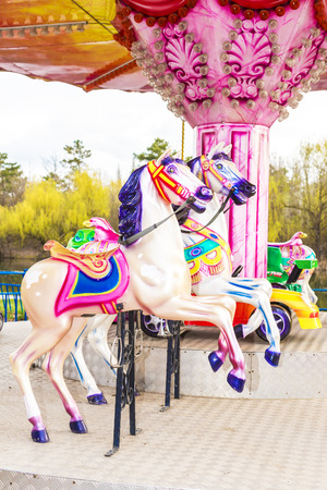 childrens carousel in the park Stock Photo