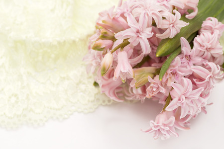 bouquet of pink hyacinths with lace photo