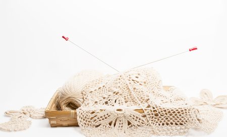 skeins and needles associated fragment of canvas