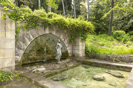 fountain in an old abandoned park photo
