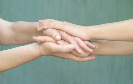 warm hands of a young girl and an old woman