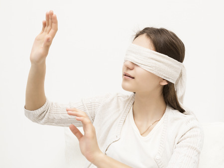 young girl with a blindfold photo