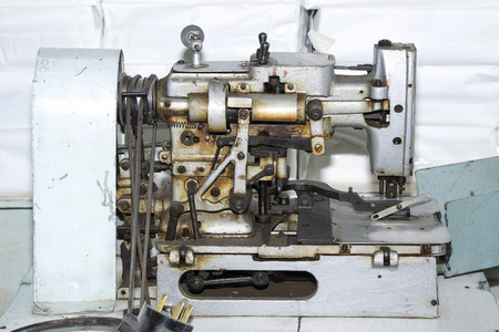 Old and dirty sewing machine photo