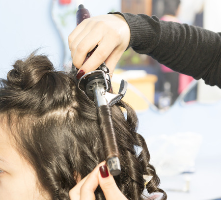 perming hair curling