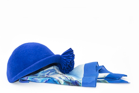 blue silk scarf and felt hat with flower