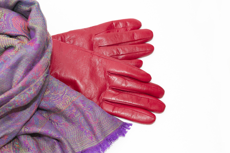 colored woolen scarf and red leather gloves Stock Photo