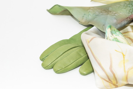 green leather gloves and scarf on white background
