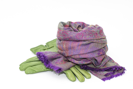 lilac scarf and green gloves Stock Photo