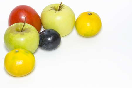 apples, persimmons, tangerines with a corner