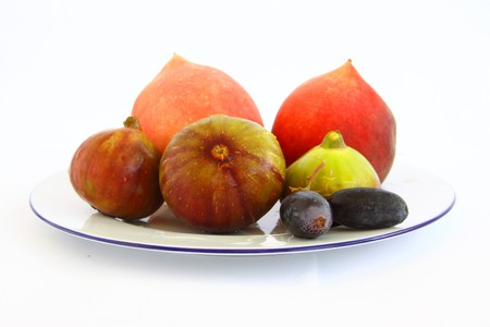 plater: Healthy vegetables grapes peach figs on white plater