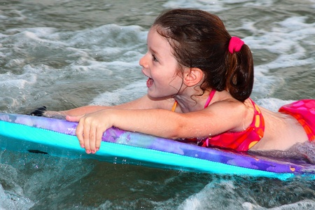 Young surfer girl is riding a wave.  Stock Photo - 10849011
