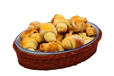 Delicious freshly baked baking in the basket  on white background Stock Photo