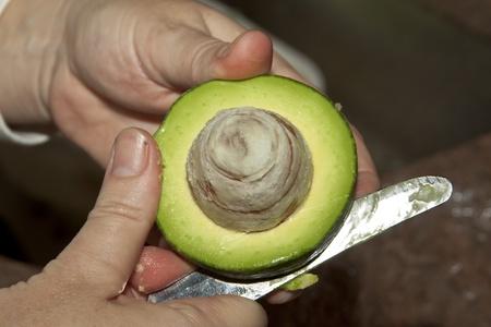 woman cutting  avocados