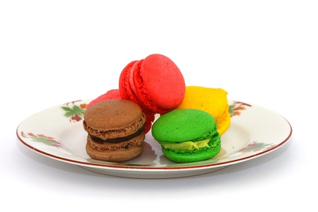 colorful macaroons dessert on  plate photo