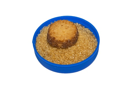 brown sugar with cookie in the lid isolated on white