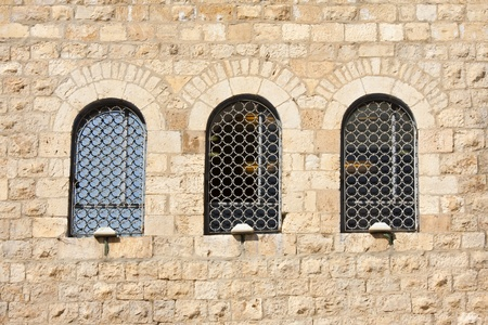 Old wall made from Jerusalem stone with  windows  photo