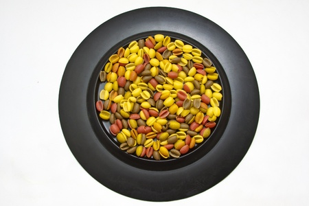 colorful pasta on black plate  on white  Stock Photo