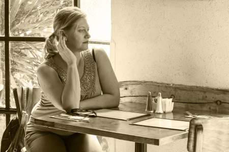 woman sitting in a cafe alone old style monochrome Stock Photo - 19028445