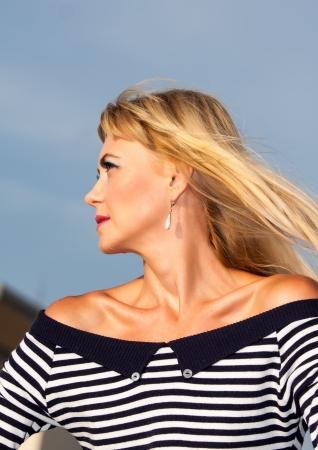 Sailor model on the beach photo