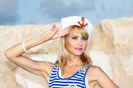 Sailor model on the beach photo
