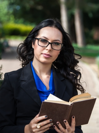 Portrait of young attractive woman with glasses and old book Stock Photo