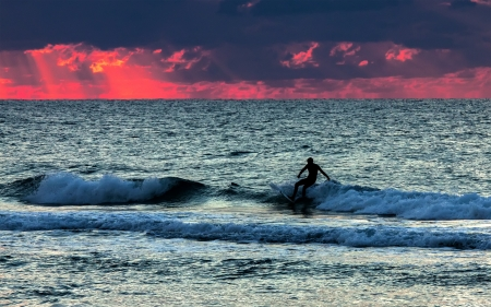 Silhouette of surfer in the sea photo