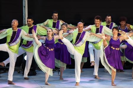 KARMIEL, ISRAEL - AUGUST 8: performance of folk dance on August 8, 2012 in Carmiel, Israel. Karmiel dance festival performance  in Karmiel Cultural Center