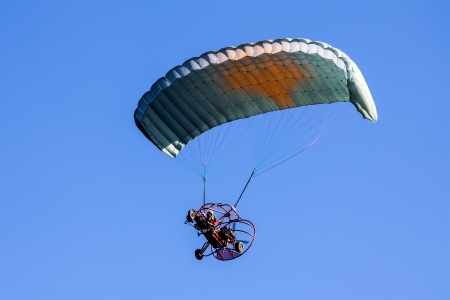 Moto paraglider on the sky Stock Photo