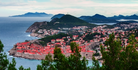 Classic red tiled rooftops with Adriatic sea photo