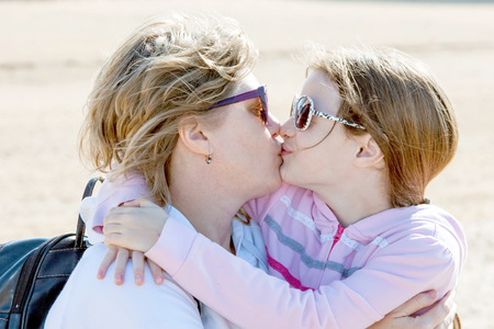 mum and daughter: A little girl and her mother together